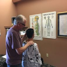 Chiropractic adjustment on woman